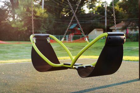 empty children playground  swing during the coronavirus quarantine