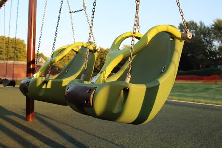 empty children playground  swing during the coronavirus quarantine Standard-Bild - 149826839