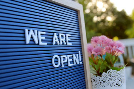 Welcome sign at the store / bar / restaurant. We are open. After COVID-19 quarantine