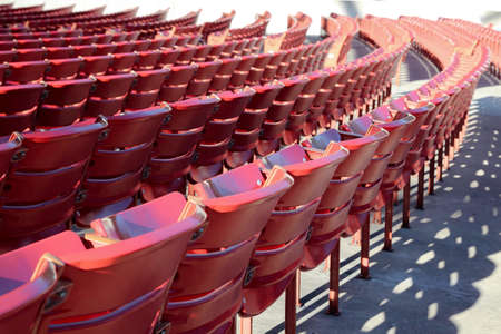 Empty raws of red chairs outside. Covid-19 quarantine 版權商用圖片