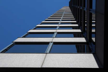 the skyscraper in a modern city with a blue sky