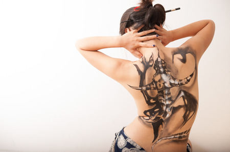 dancer with a dragon tatoo on the back