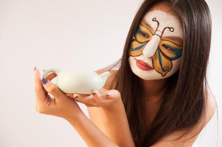 art woman holding a teapot