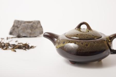 chinese tea pot: Chinese Tea pot and tea leaves