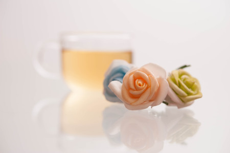 Teacup with tea and flower presentation