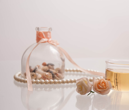 pearl tea: Presentation of pearl necklace and teacup with tea
