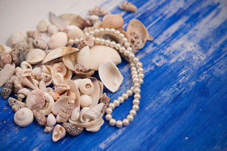 margarite: Pearl necklace and seashells