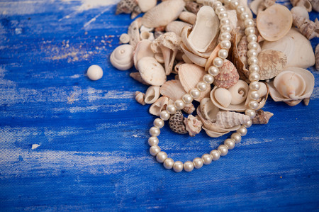 margarite: Seashells and pearl necklace
