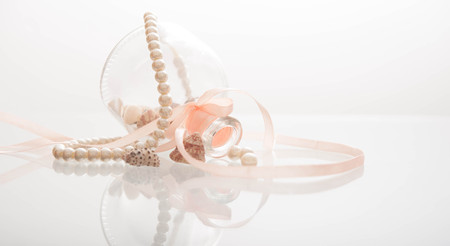 margarite: Pearl necklace tangle up on a glass container