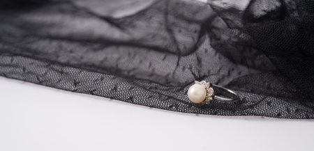 jewellry: a pearl ring on the lace fabric can be used as background of jewellry or wedding