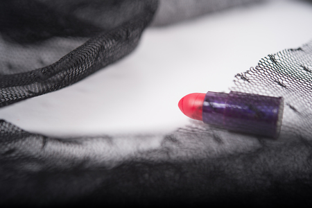 studioshot: one single lipstick with lace fabric