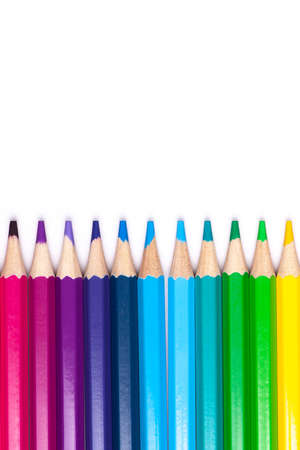 multicolored wooden pencils in rainbow shades in order on a white isolated background mock up, vertical, high quality