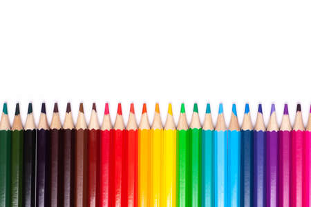 multicolored wooden pencils in rainbow shades in line on a white isolated background mock up, horizontal