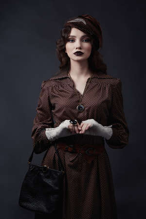 Woman in retro style of 1920s years.