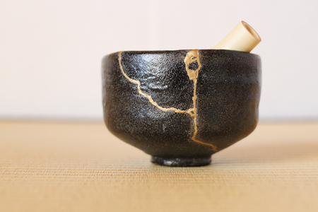 Repair of crack pottery tea cup and bamboo whisk  horizontal Reklamní fotografie