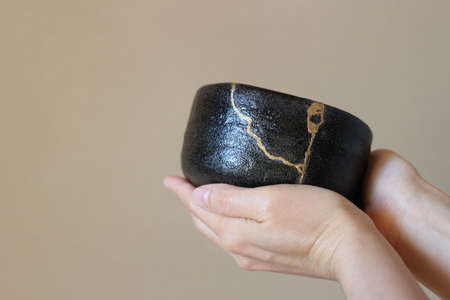 Repair of crack pottery tea cup  vertical