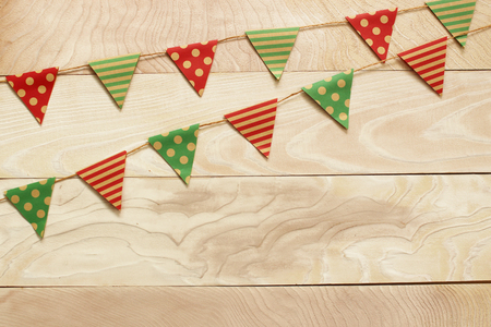 Garland with flags. Decorative colorful party pennants for Holiday background with wood
