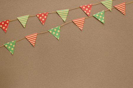 Garland with flags. Decorative colorful party pennants for Holiday background with textured paper