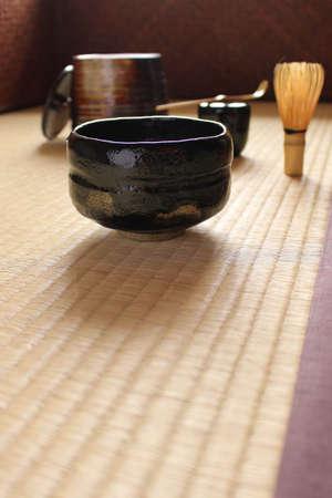 Matcha teacups and tea utensils preparing Japanese tea ceremony in a Japanese-style room