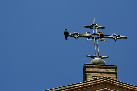 crucifix and birds on blue sky
