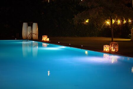 night swimming pool and candles Archivio Fotografico