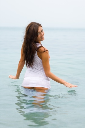 Attractive girl in white T-shirt in the sea Stock Photo - 9651429