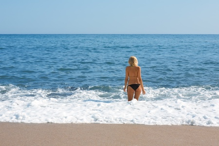 Attractive girl among the ocean waves. photo