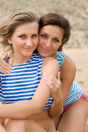 Two beautiful smiling girl on the beach Stock Photo - 9749558