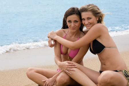 Two beautiful smiling girl on the beach. Stock Photo - 9835691