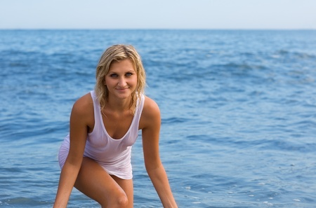 Beautiful young sexy woman against the sea  photo