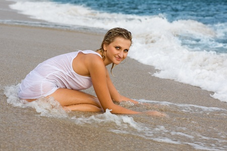 Attractive young blond girl on the beach. photo