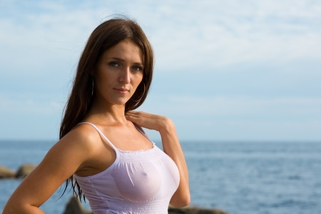sexy breast: Young sexy brunette woman at the sea. Stock Photo