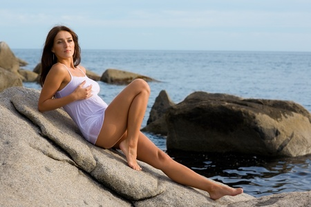 Beautiful young sexy brunette woman at the sea. photo
