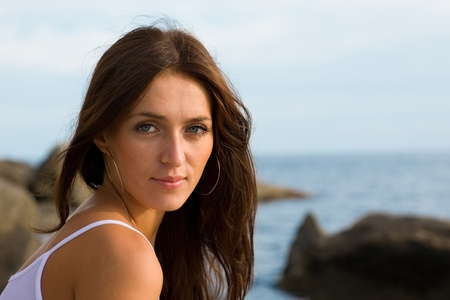 Beautiful young brunette woman at the sea. Stock Photo - 9835694
