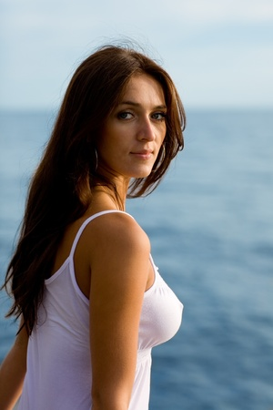 Beautiful girl in the evening by the sea. photo