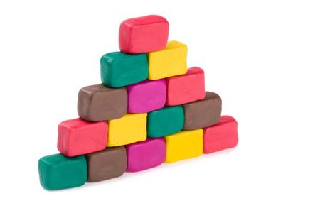 Pyramid of bricks made of colored plasticine. photo