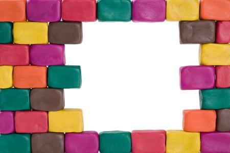 Frame of bricks made of colored plasticine. photo