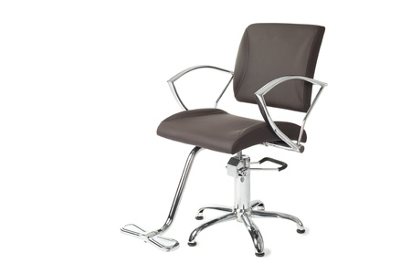 designer chair: Contemporary barber chair isolated on white. Stock Photo