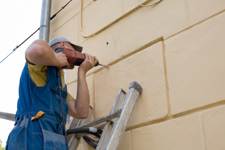 Setup man performs work on installing a new air conditioner. Stock Photo - 10298846