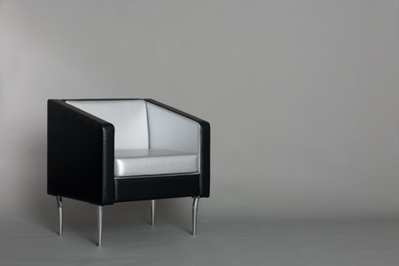 Lounge chair with a gray background. Modern design. photo