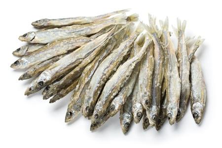 sprat: Dried salted sprat isolated on white.