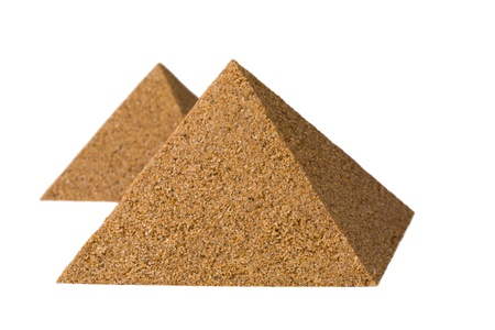 Pyramids of sand. Isolated on a white. Stock Photo - 10306796