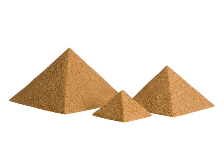 Pyramids of sand. Isolated on a white. photo
