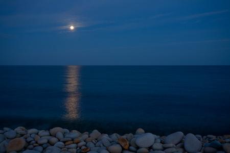 Marine rocky shore of a large pebble. photo