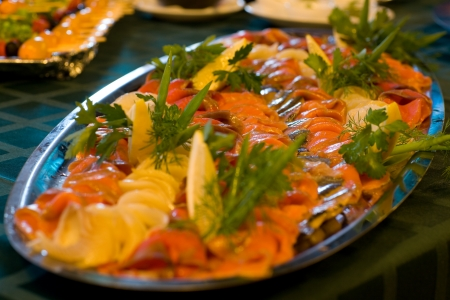 Smoked salted salmon appetizers. Served banquet table. photo