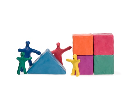 Family on the construction of a house. Plasticine. Stock Photo - 10309479
