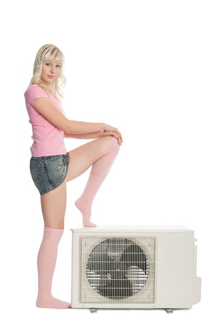 Beautiful girl with a new model for the air conditioner. photo