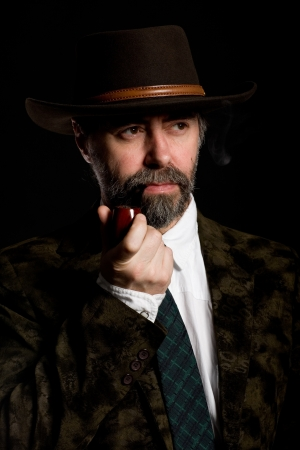 Stylish middle aged man with a smoking pipe. Stock Photo - 10309398