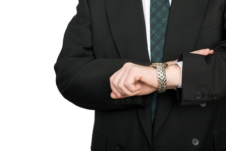 wrist: Businessman checking the time on his wristwatch. Stock Photo