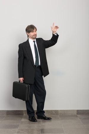 Businessman with arm raised in salute. Stock Photo - 10309385